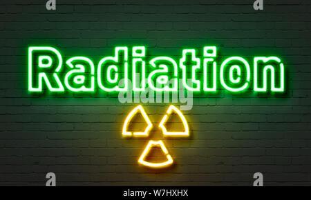 Radiation neon sign on brick wall background - Stock Photo