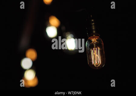 Close up hanging light bulbs - retro style. - Stock Photo