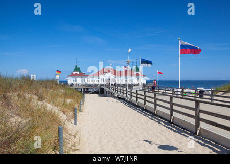 Ahlbeck, Germany - August 3, 2019: Ahlbeck Pier is located in Ahlbeck, on the island of Usedom. It is the oldest pier in Germany.The pier stretches fr - Stock Photo