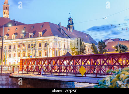 WROCLAW, POLAND - August 05, 2019: Nightview of the Most Piaskowy the Red Bridge against The Ossolineum or the National Ossoliński Institute in Wrocla - Stock Photo