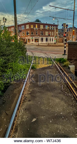 Tram tracks in the Voorburg district of The Hague (Den Haag), The Netherlands. Dusk. - Stock Photo