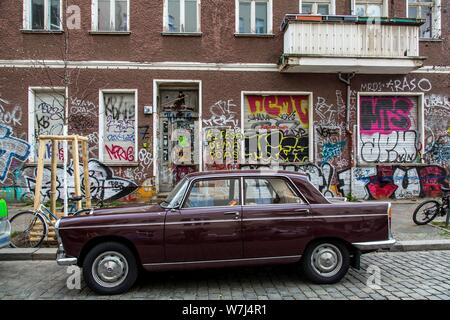 Graffiti, painting, old house at Dirschauer Strasse, in the district Friedrichshain, Berlin, Germany - Stock Photo