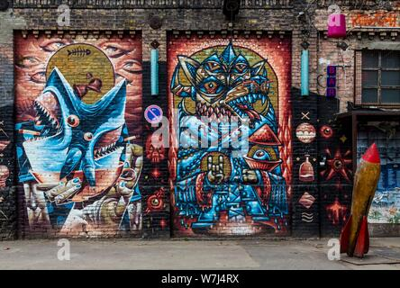 Graffiti, painting on the RAW premises at Revaler Strasse, in the district Friedrichshain, Berlin, Germany - Stock Photo