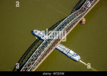 Aerial view, bridge over the Rhine, cargo ship passes south bridge, Cologne, Rhineland, North Rhine-Westphalia, Germany - Stock Photo