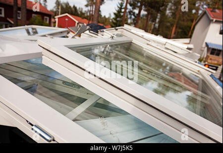 a large container with old windows thrown in a pile - Stock Photo