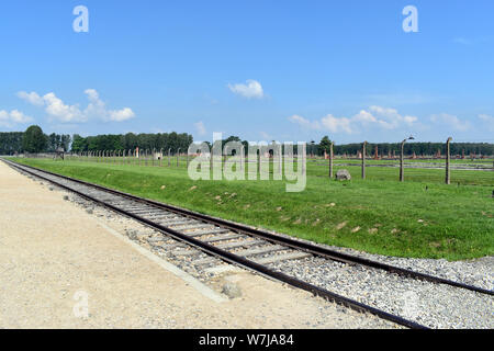 Birkenau/Poland-June 3, 2019: A general view of the demolished accommodation buildings and a control tower at the Birkenau Concentration Camp in Polan - Stock Photo