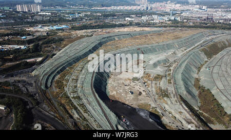 Aerial view of the Fushun West Open Coal Mine, the largest open coal mine in Asia, in Fushun city, northeast China's Liaoning province, 29 September 2 - Stock Photo