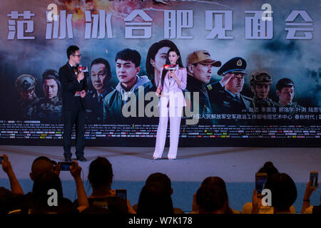 Chinese actress Fan Bingbing, right, attends a fan meeting for her new movie 'Sky Hunter' in Hefei city, east China's Anhui province, 23 September 201 - Stock Photo