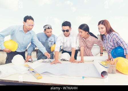 Asian team engineer working in construction site. construction concept - Stock Photo