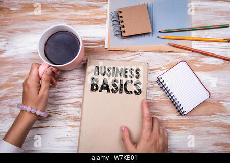 Business Basics. Hands holding book - Stock Photo