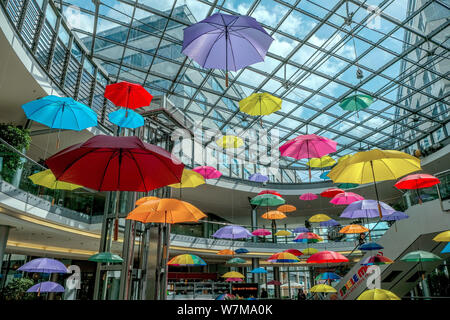 Magdeburg, Germany. 03rd May, 2019. Colourful umbrellas hang as an artistic installation in a shopping centre in Magdeburg. Credit: Peter Förster/dpa-Zentralbild/ZB/dpa/Alamy Live News - Stock Photo