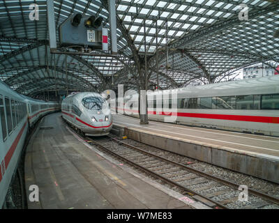 Cologne, Germany - May 24, 2019: high speed trains in the main station - Stock Photo