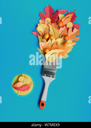 Top view on flat lay with brush loaded with paint made from paper Autumn leaves. Concept home renovation background in blue, yellow, orange and red co