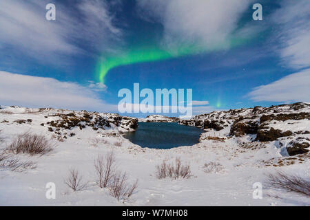 Northern lights / Aurora borealis over snowy landscape, Iceland, Europe, March 2012 - Stock Photo