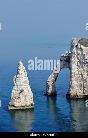 The sea stack L'Aiguille and the Porte D'Aval, a natural arch in the chalk cliffs at Etretat, Côte d'Albâtre, Upper Normandy, France, March - Stock Photo