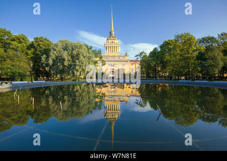 SAINT-PETERSBURG, RUSSIA - JULY 25, 2019: The facade of the Admiralty building with a reflection in the fountain on a sunny July morning - Stock Photo