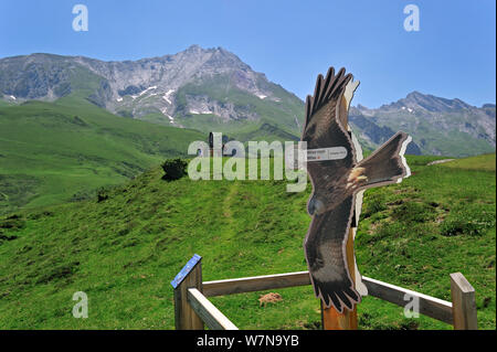Viewpoint with sign depicting a Red kite (Milvus milvus) for watching birds of prey at the Col du Soulor, Hautes-Pyrenees, Pyrenees, France, June 2012 - Stock Photo