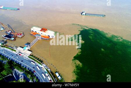 The Yangtze River meets the Hanjiang River at the Dragon King Temple district in Wuhan city, central China's Hubei province, 5 July 2017.   Aerial pho - Stock Photo