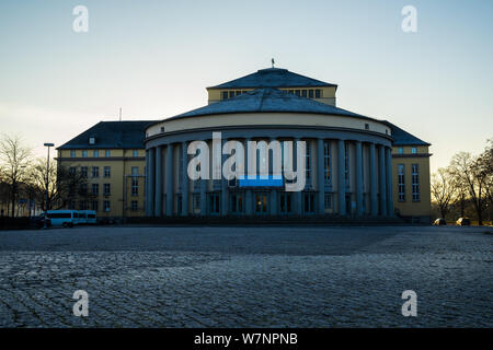 Germany, Ancient theatre building in old town of saarbruecken city in warm morning sunlight - Stock Photo