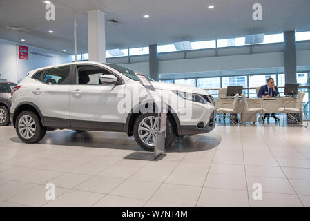 ST. PETERSBURG, RUSSIA - JULY 09, 2019: White new Nissan Qashqai in car showroom of the official dealer - Stock Photo