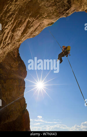 Woman rappels down from ascent of the climb 'Birds in a Rut' near Smith Rock, eastern Oregon, USA. September 2012. Model released - Stock Photo