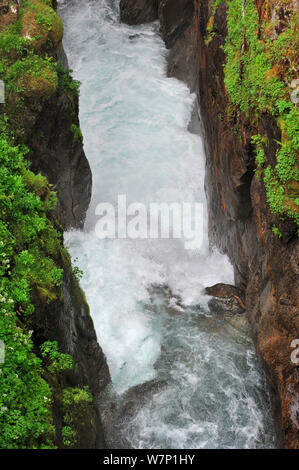 Waterfall running through narrow gorge at the Pont d'Espagne in the Hautes-Pyrenees near Cauterets, Pyrenees, France, June 2012 - Stock Photo
