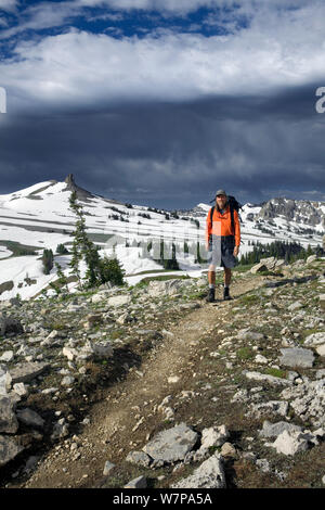 Man hiking along the Death Canyon Shelf on the Teton Crest Trail in Grand Teton National Park. Wyoming, USA, July 2011 - Stock Photo