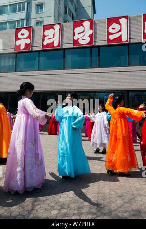 Women in traditional dress dancing during street celebrations on the 100th anniversary of the birth of President Kim IL Sung, Pyongyang, Democratic Peoples' Republic of Korea (DPRK), North Korea, April 15 2012 - Stock Photo