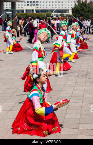 Children in traditional dress dancing during street celebrations on the 100th anniversary of the birth of President Kim IL Sung, Pyongyang, Democratic Peoples' Republic of Korea (DPRK), North Korea, April 15 2012 - Stock Photo