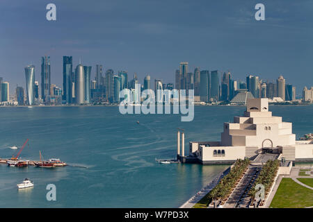 Elevated view over the Museum of Islamic Art and the Dhow harbour to the modern skyscraper skyline of Doha, Qatar, Arabian Peninsula 2011 - Stock Photo