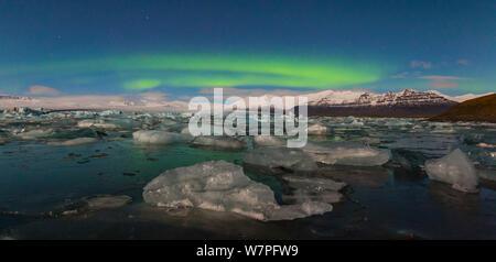 Aurora borealis over Jokulsarlon glacier lagoon. Southern Iceland, Europe, November 2012. - Stock Photo