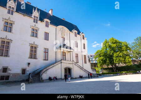 Nantes, France - May 12, 2019: Tourists walking in the courtyard of Castle of the Dukes of Brittany in Nantes, France - Stock Photo