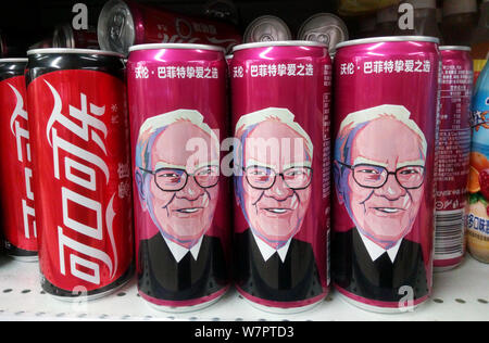 Cans of Cherry Coca-Cola with a portrait of Warren Buffett, Chairman and CEO of Berkshire Hathaway, are for sale on the shelf with other soft drinks a - Stock Photo