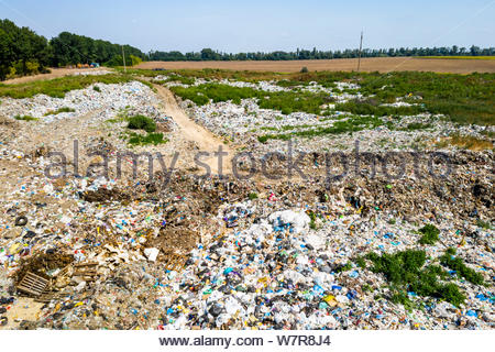 Aerial view of dump in forest. Pollution concept, top view. - Stock Photo
