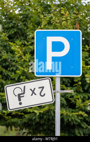06 August 2019, Saxony, Bad Gottleuba-Berggießhübel: In front of a supermarket in Bad Gottleuba-Berggießhübel near Pirna, an additional sign for two parking spaces for people with disabilities is upside down on a disabled parking lot. Photo: Daniel Schäfer/dpa-Zentralbild/dpa - Stock Photo