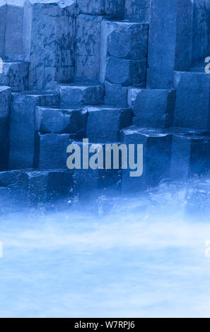 Mist around the basalt columns of Giant's Causeway, UNESCO World Heritage Site, County Antrim, Northern Ireland, Europe, June 2011 - Stock Photo
