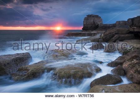Waves break over the rocky shoreline of Portland Bill, Isle of Portland, Dorset, England. April 2012. - Stock Photo