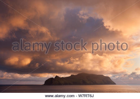 Spectacular sunset skies above the island of Mykines, Faroe Islands. May 2012. - Stock Photo
