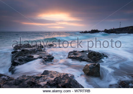 Sunrise at Porthgwidden Beach in St Ives, Cornwall, England. March 2013. - Stock Photo