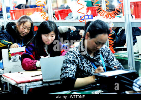 --FILE--Female Chinese workers make LED Lights to be exported at a factory in Yushan county, Shangrao city, east China's Jiangxi province, 28 March 20 - Stock Photo