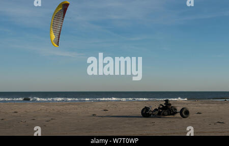Man in kite buggy on beach, St Louis du Rhone, Camargue, France, October 2012. - Stock Photo