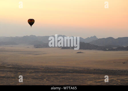 Hot air balloon ride over the Namib desert at sunset, Namibia, February 2005. - Stock Photo