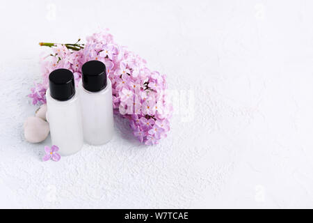 Hygiene products. Conditioner and shampoo for hair. Mockup with cosmetics. Copy space. Natural lilac. Soft focus - Stock Photo