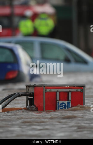 Emergency services pumping floodwaters, after sea defences were breached at Splash Point in Rhyl, Denbighshire, Wales, 5th December 2013. - Stock Photo