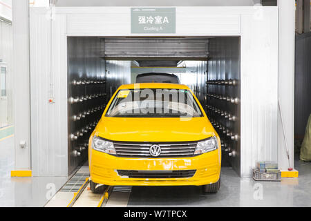 --FILE--A car is being assembled on the assembly line at an auto plant of SAIC Volkswagen, a joint venture between SAIC Motor and VW, in Shanghai, Chi - Stock Photo