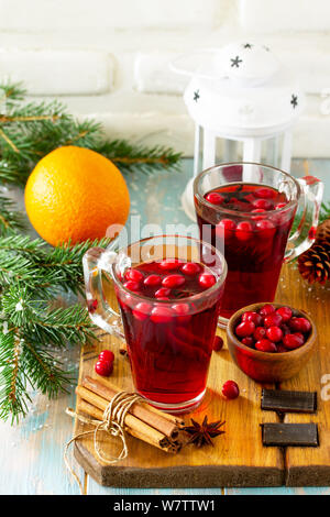Christmas, Thanksgiving drinks. Hot winter drink with cranberries and cinnamon on wooden table. Copy space for your text. - Stock Photo