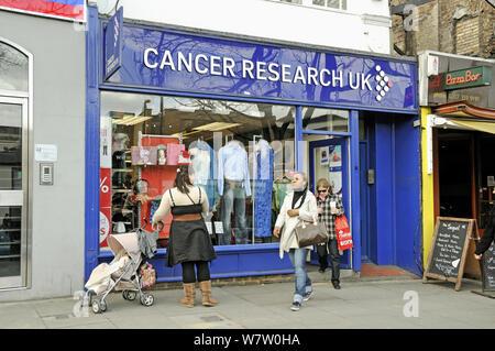 Women leaving Cancer Research UK charity shop, Upper Street, London Borough of Islington, London, England, UK, March 2009 - Stock Photo