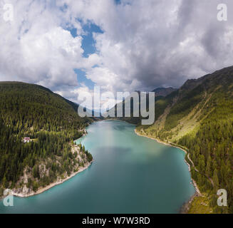 The beauty of the mountains and alpine lakes, where you can relax in front of this show. - Stock Photo