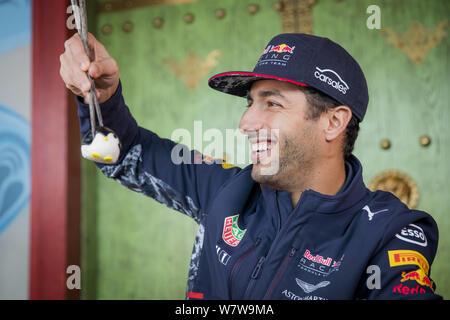 Australian F1 driver Daniel Ricciardo of Red Bull Racing is pictured as he eats snacks in Hong Kong, China, 6 April 2017. - Stock Photo