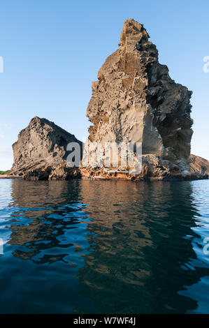 Pinnacle Rock, remnant of old eroded tuff cone, Bartolome Island. Galapagos Islands, June 2011. - Stock Photo